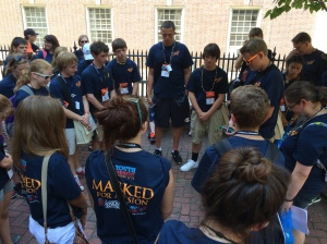 Trevor Mahan leads our pilgrimage group in prayer after visiting Christ Church in Philadelphia during EYE '14. Christ Church is credited as being the first Episcopal Church!