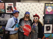 Tyler Kerr, Karen Schlabach, and Greta Carlson at the Episcopal Service Corps booth at General Convention 2015.